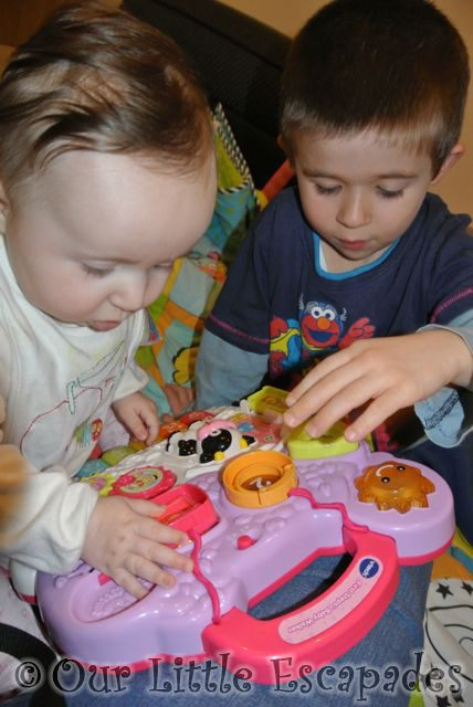ethan little e playing vtech toys