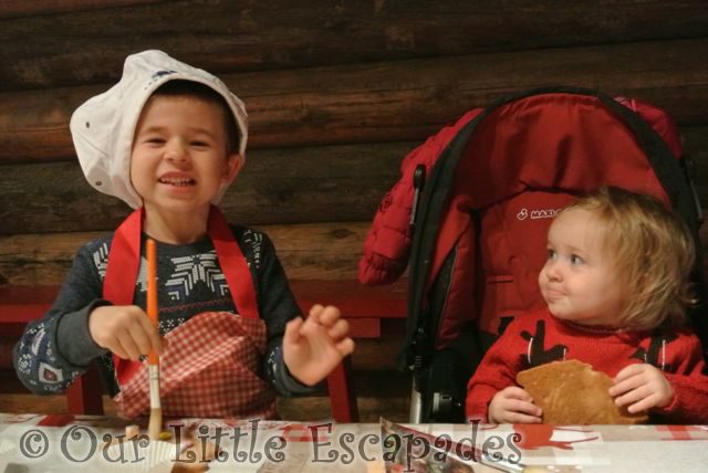 ethan decorating gingerbread little e lapland uk December 2015