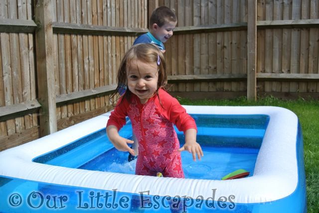 little e ethan playing paddling pool