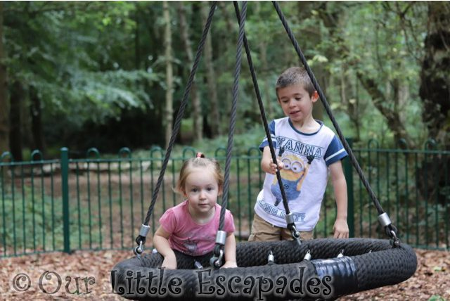 ethan little e playing circle swing highwoods country park