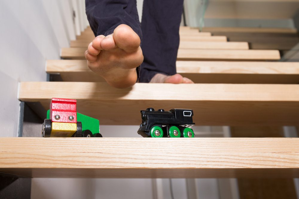 man treading wooden trains stairs