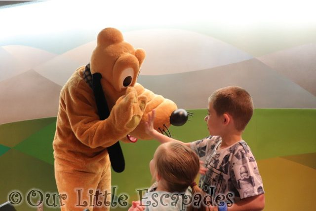 little e ethan high five pluto garden grill epcot walt disney world