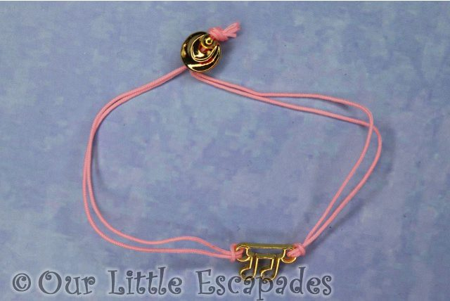 pink collectible bracelet musical note