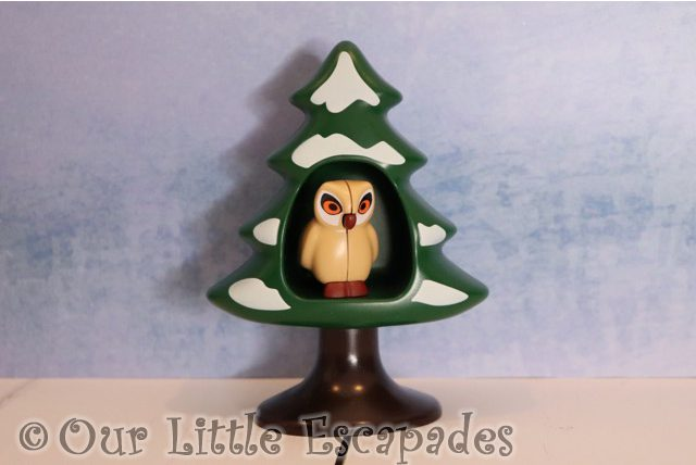 owl snow covered tree