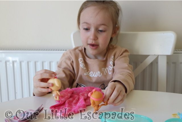 little e playing baby born surprise pets
