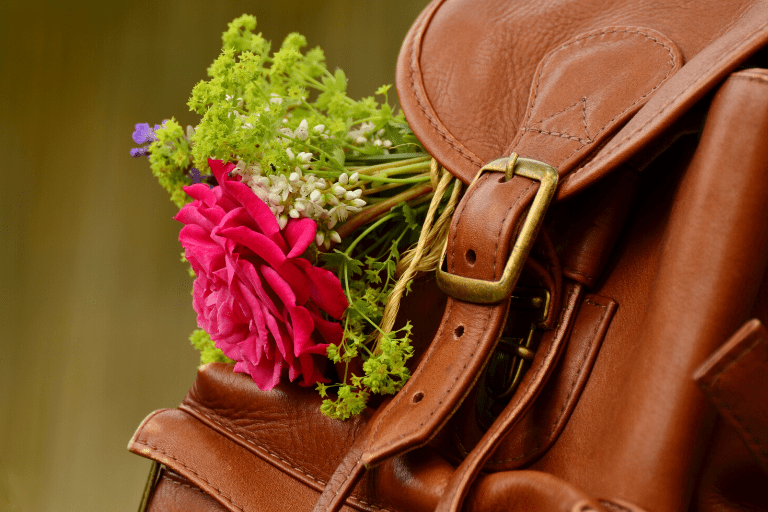brown leather rucksack red flowers