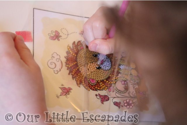 little e placing cream crystals lion template