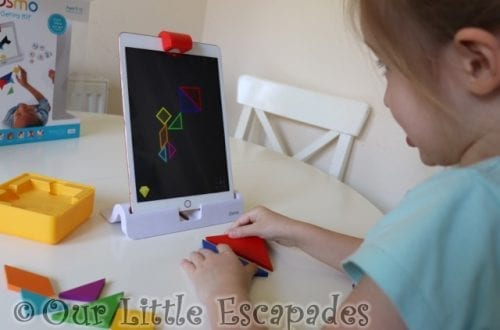 little e playing tangram home learning with osmo
