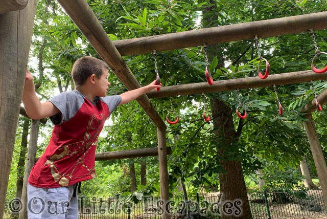 ethan reaching for monkey bars childrens play area highwoods country park