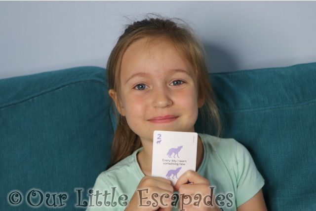 little e holding teaching card
