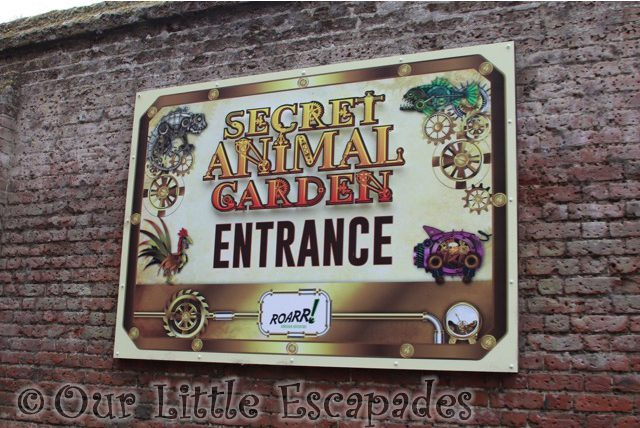 secret animal garden sign