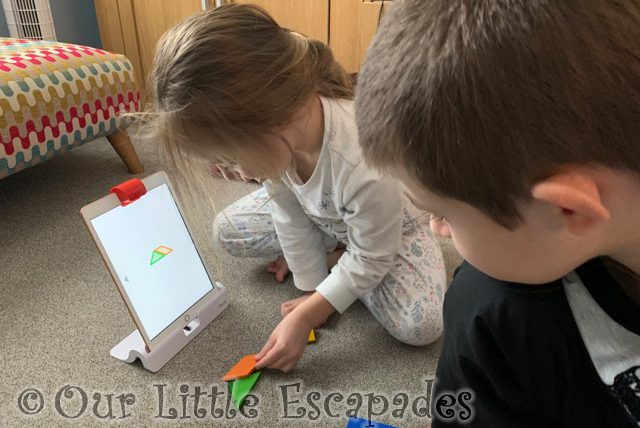 ethan little e playing osmo together