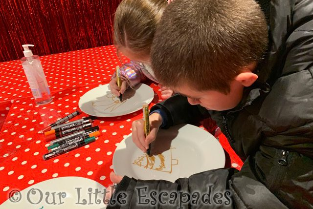 ethan little e concentrating decorating christmas plates santas grotto fenwick