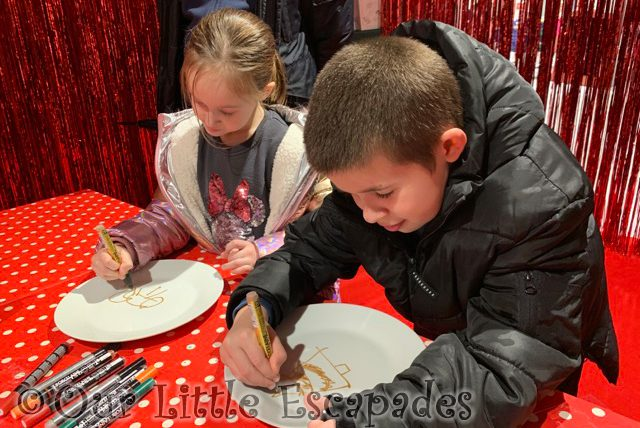 ethan little e decorating christmas plates santas grotto fenwick