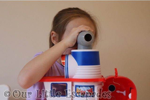 little e looking through telescope