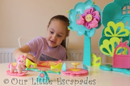 little e playing treehouse rocking horse seesaw carousel baby born surprise treehouse