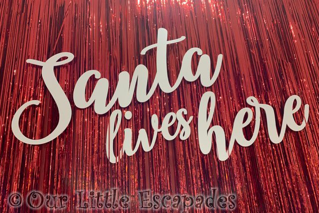 santa lives here sign