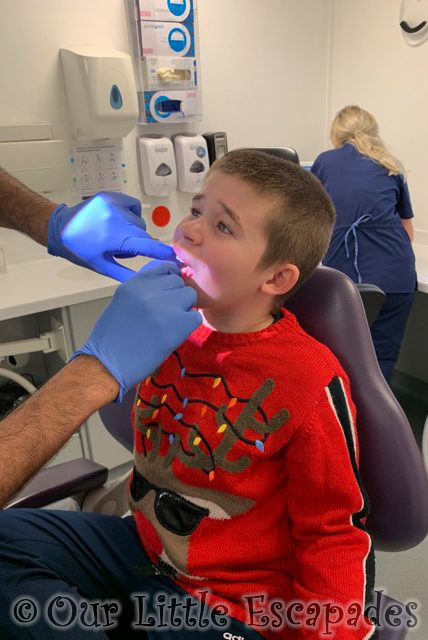 dentist checking ethans wobbly tooth