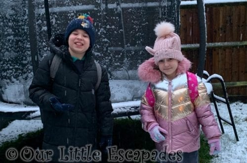 ethan little e smiling snowy garden snowy walk to school