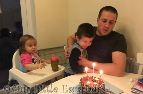 little e ethan darren blowing out candles birthday cake