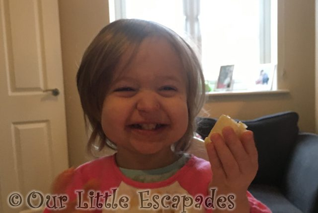 little e laughing eating banana featured image