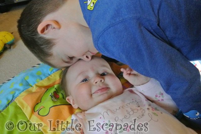 little e smiling ethan head cuddles my sunday photo