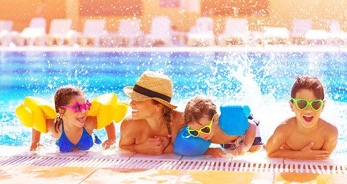 family swimming pool holiday