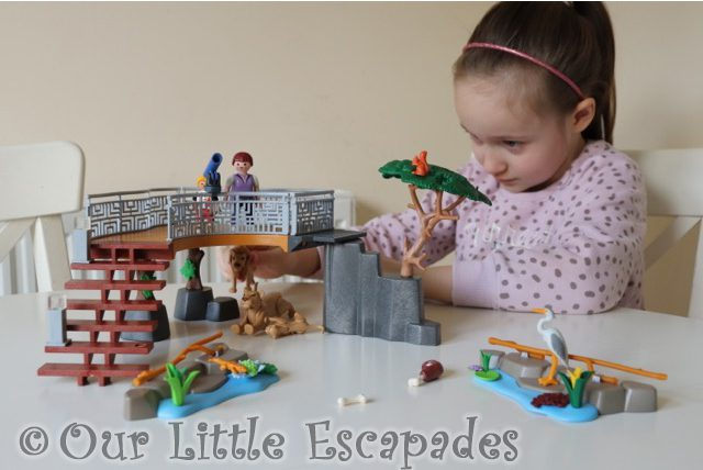little e playing playmobil outdoor lion enclosure