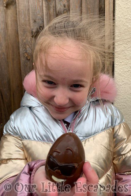 little e holding chocolate egg with face 2021 Week 20