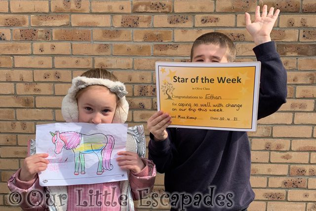 little e holding unicorn drawing ethan holding star of the week