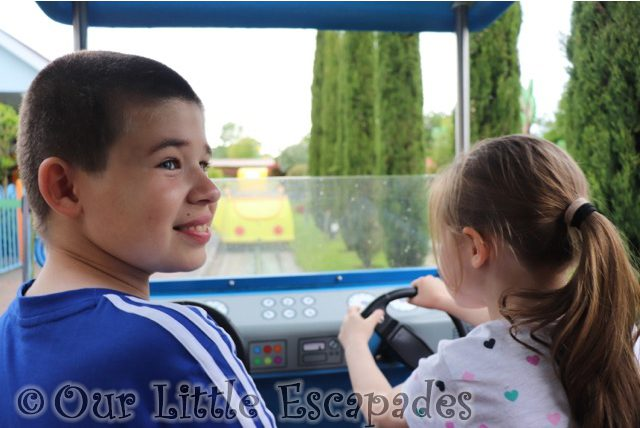 ethan smiling little e driving daddy pigs car ride peppa pig world